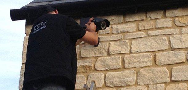 CCTV installer fitting bullet cam
